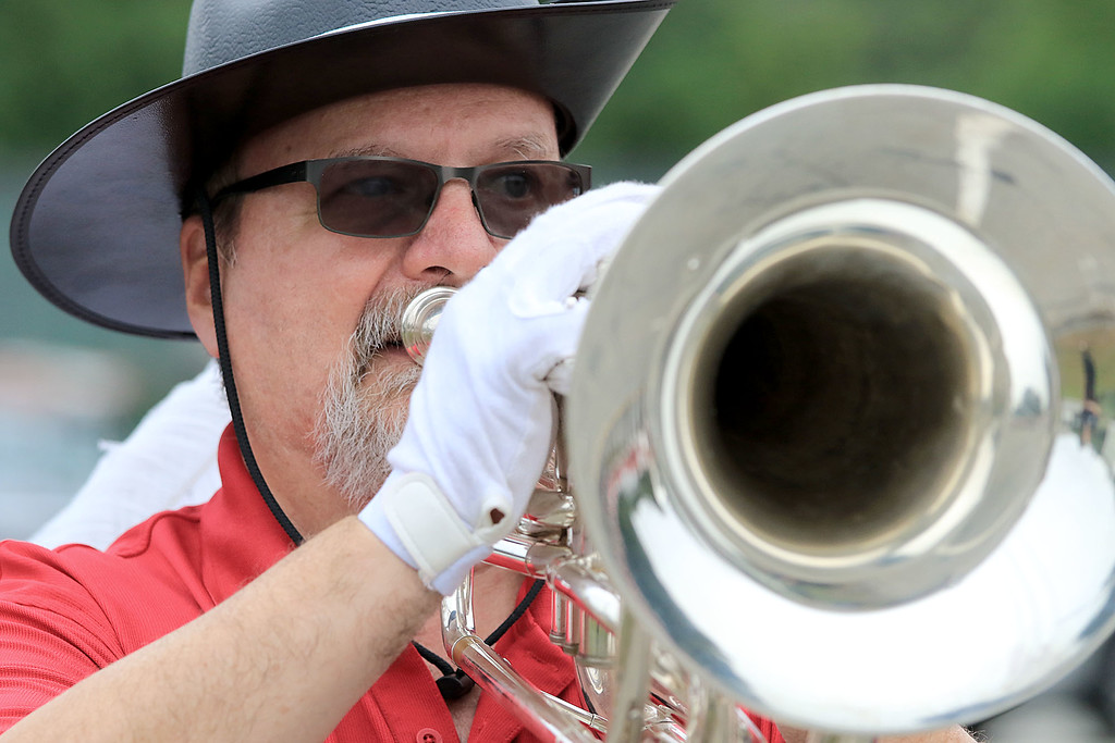 . Playing the Baratone Bugle in the Billerica Yankee Doodle Homecoming Parade on Saturday, September 15, 2018is Dennis Daly. SUN/JOHN LOVE