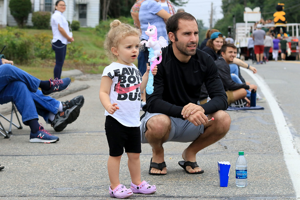 . Watching the Billerica Yankee Doodle Homecoming Parade on Saturday, September 15, 2018 is Audriana Scarpaci, 2, with her dad Jarrett Scsarpaci from Dracut. SUN/JOHN LOVE