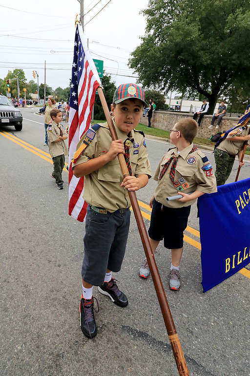 . Carring the American flag in the Billerica Yankee Doodle Homecoming Parade on Saturday, September 15, 2018 is James Hill, 10, with Cub Scout Pack 54 of Billerica. SUN/JOHN LOVE