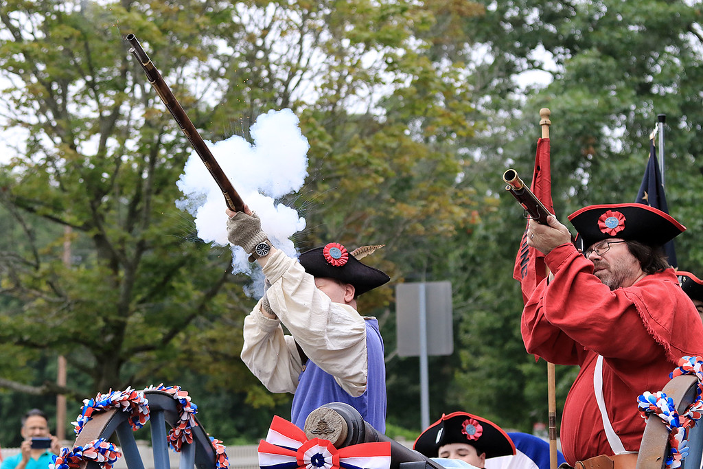 . Firing off some shots in the Billerica Yankee Doodle Homecoming Parade on Saturday, September 15, 2018 with the Reading and North Reading Minutemen is Brad Brooks, L, and Private Billy Peacock. SUN/JOHN LOVE