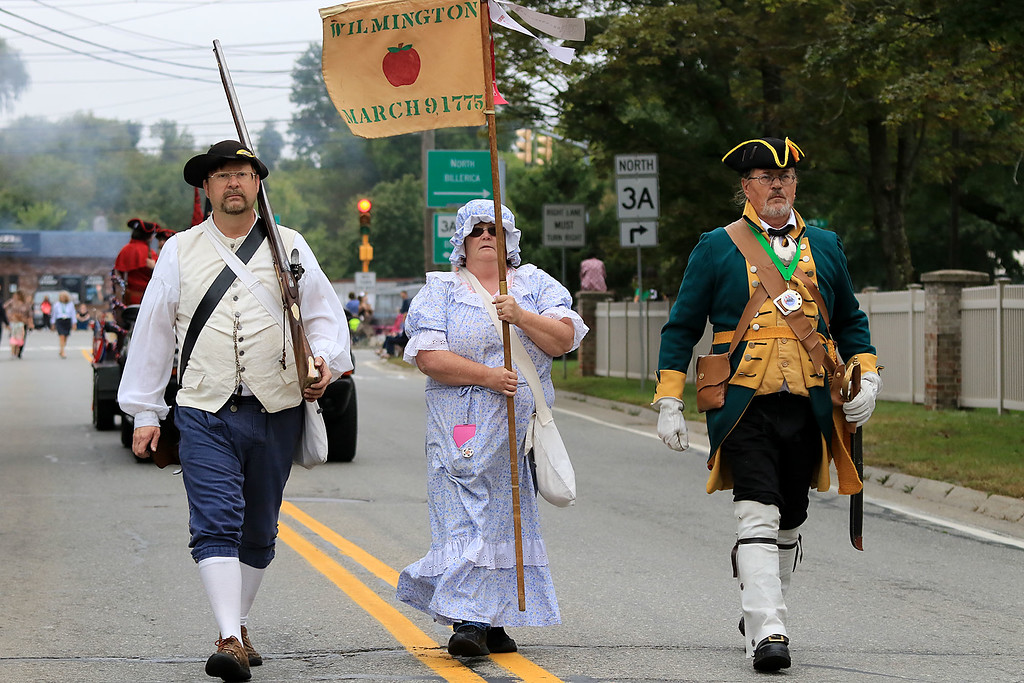 . Walking in the Billerica Yankee Doodle Homecoming Parade on Saturday, September 15, 2018 with the Wilmington Minutemen is from left Company Sgt. Frank West, Private Karen West and Captain Mike Kelley. SUN/JOHN LOVE