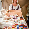 Jennifer Rich of Tewksbury sells toys from that time period at the Yankee Doodle event in Billerica. SUN/Caley McGuane