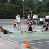 """Band and color guard members jump and sway during their debut of """"Gene Dreams"""" on Aug. 26. -- photo by Mary Leach"""