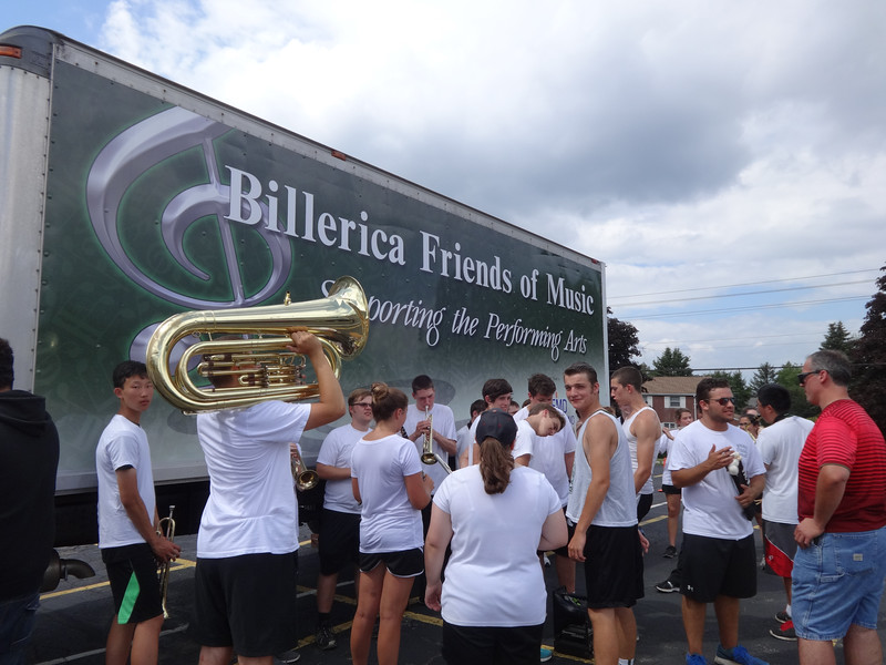 Members of the Billerica Memorial High School band and color guard gather in the Good Street parking lot before their performance on Aug. 26. -- photo by Mary Leach