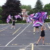 A simple parking seems magical as the Billerica Memorial High School color guard jumps and waves colorful flags. -- photo by Mary Leach