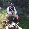 Richard Kunicki of Billerica demonstrated how a gourd would have been used to make a bowl in the Billerica Colonial Minute Men's camp at Old Sturbridge Village. -- photo by Mary Leach