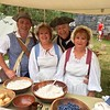 Cindy Hawes, Elaine Kunicki, Dick Kunicki and Tom Boisvert seem to enjoy stepping back in time in the Billerica Colonial Minute Men's encampment at Old Sturbridge Village. -- photo by Mary Leach