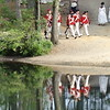 Old Sturbridge Village was transformed into a Revolutionary-era environment as more than 1,000 reenactors gathered for the Redcoats & Rebels weekend on Aug. 6 and 7. The redcoats marched to battle by  a mill pond. -- photo by Mary Leach
