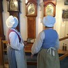 Elaine Kunicki and Cindy Hawes, both of Billerica, step away from their colonial camp at Old Sturbridge Village to visit the clock gallery. -- photo by Mary Leach