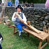Bill Brimer of Tewksbury demonstrates woodworking at the Billerica Colonial Minute Men's encampment. The group performed living history demonstrations at Old Sturbridge Village on Aug. 6 and 7. -- photo by Mary Leach
