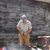 Tom Boisvert of Natick, a member of the Billerica Colonial Minute Men, shapes molten metal into a musket ball during the Redcoats & Rebels Weekend at Old Sturbridge Village. -- photo by Mary Leach