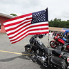 An American flag  blew in the breeze on a motorcycle at the fifth annual Vets1st event. Photo by Mary Leach