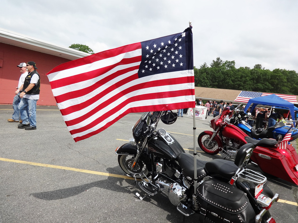 . An American flag  blew in the breeze on a motorcycle at the fifth annual Vets1st event. Photo by Mary Leach