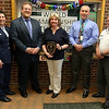 Cyril D. Locke Middle School teacher Maureen Parker, center,  receiving the Aerospace Education Teacher of the Year award on Wednesday afternoon at the school.From left is Lt. Col Shelley Rosenbaum-Lipman, Superintendent Timothy G Piwowar, Maureen Parker, Assistant Principal Phillip Peters  and Col. Everett Hume. SUN/JOHN LOVE