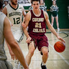 At right, Concord Carlisle's David Poor dribbles the ball down the court with Billerica's Tyler Bradanese close by him as they run to the net. SUN/Caley McGuane