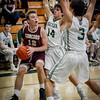 At left, Concord Carlisle's John Mulligan looks to shoot as Billerica's Clifton Trethewey (14) and Alexander Frawkey try to block him. SUN/Caley McGuane