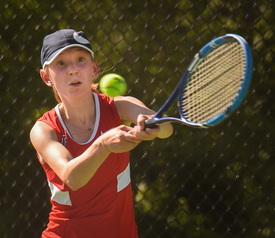 . Elizabeth Ezekiel, a junior from Tewksbury, returns with a backhand in singles play Monday at Billerica against Sarah Bojsen, a senior at BHS.  Photo: SUN/Scot Langdon