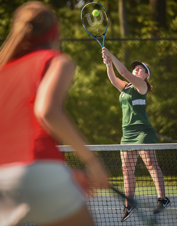 . Laney Wyatt, a sophomore at Billerica, returns a serve back to Tewksbury in doubles play on Monday.  Photo: SUN/Scot Langdon
