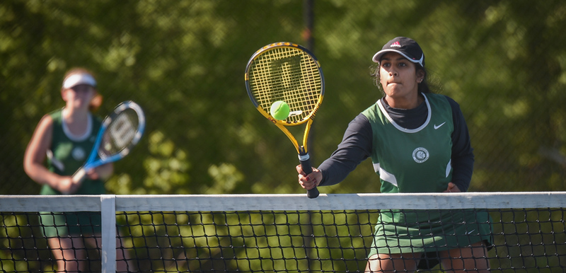 . Madhu Velmurugan, a junior at Billerica, taps in a short drop over the net against Tewksbury Monday afternoon in doubles play at Billerica.  Teammate, Laney Wyatt, a sophomore, backs her up.   Photo: SUN/Scot Langdon
