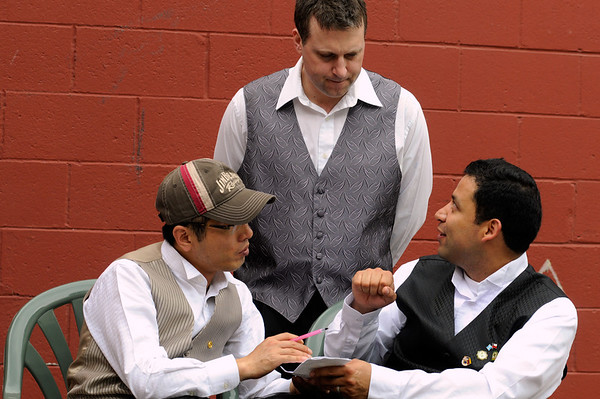 Dan Kolacz listens to Miguel Torres and Seong Kim