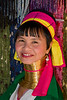 A woman of the Long Neck (Karen) tribe  in Chiang Rai Thailand, showing off her golden neck decorations.