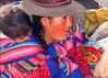 Woman and child at the open market of Pisac, Peru.