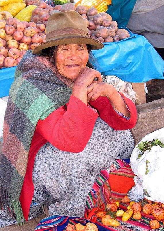 Old potato vendor at the open market in Pisac, Peru