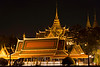 Temple of Dawn at night on the Chao Phraya river in Bangkok, Thailand