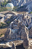 Baloon over homes carved into tufa formations in Cappadocia, Turkey