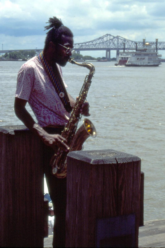 Hot Sax-Cool dude, on the bank of the Mississippi River, New Orleans, Louisiana.