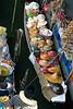 Selling produce and hats at the Floating market, Bangkok