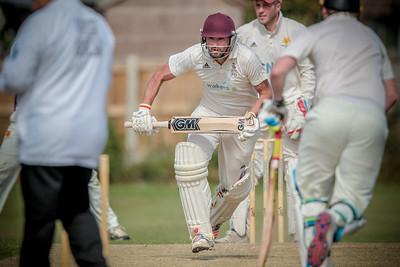 Ilkley batsmen runs between the wickets for a single.
