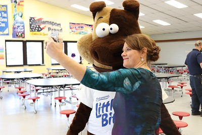 """Former Lycoming Valley Intermediate School PTO member Rose-Marie Gross (now a volunteer and member of the WASD Education Foundation Board of Directors) takes a selfie with """"LB"""" as they wait for students to arrive."""