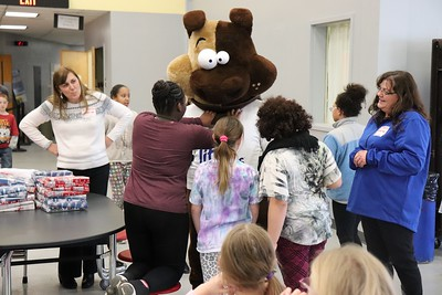 Students get playful with LB as they wait for their classmates to arrive.