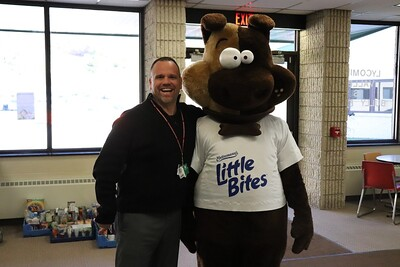 """Principal Mr. Tim Fausnaught takes a moment to pose with """"LB."""""""