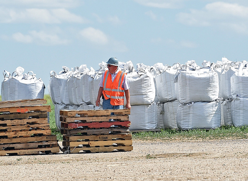 Jim Geist, chief operating officer for Biochar Now, works near full bags of biochar Tuesday, June 13, 2017, at the business in Berthoud. They use waste wood such as beetle killed pines and pallets and heat it in special kilns to make their biochar which can be used to make soil more productive, clean water and reduce odors. (Photo by Jenny Sparks/Loveland Reporter-Herald)