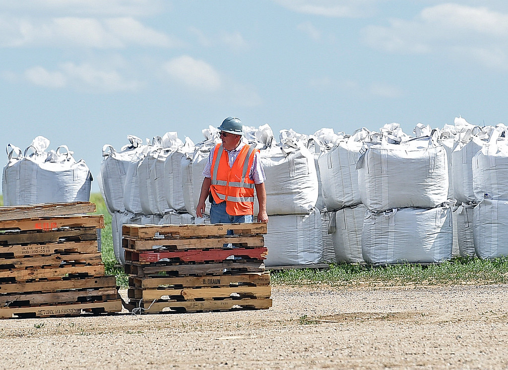 . Jim Geist, chief operating officer for Biochar Now, works near full bags of biochar Tuesday, June 13, 2017, at the business in Berthoud. They use waste wood such as beetle killed pines and pallets and heat it in special kilns to make their biochar which can be used to make soil more productive, clean water and reduce odors. (Photo by Jenny Sparks/Loveland Reporter-Herald)