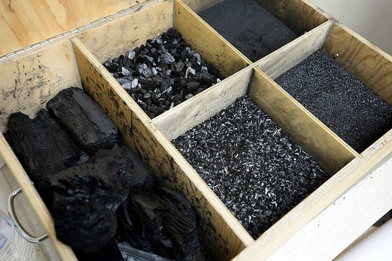 Some of the various products available are displayed in a box Tuesday, June 13, 2017, at Biochar Now in Berthoud. They use waste wood such as beetle killed pines and pallets and heat it in special kilns to make their biochar which can be used to make soil more productive, clean water and reduce odors. (Photo by Jenny Sparks/Loveland Reporter-Herald)