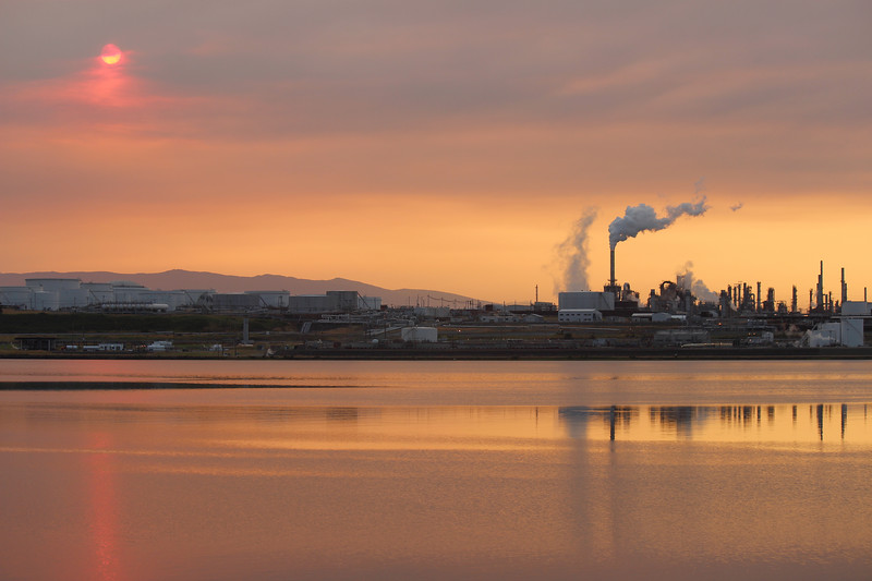Record drought, record heat. Sunrise over the Shell Puget Sound Refinery in Anacortes, Washington. Smoke from wildfires in the Olympic Peninsula and British Columbia obscures the sky. July 5, 2015.