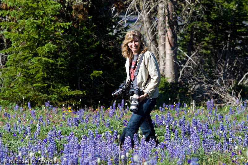 Photographer, female, MT - Me in the wildflowers, Pryor Mountains, while photographing Wild Horses with my friend and amazing Nature photographer, Mike Francis