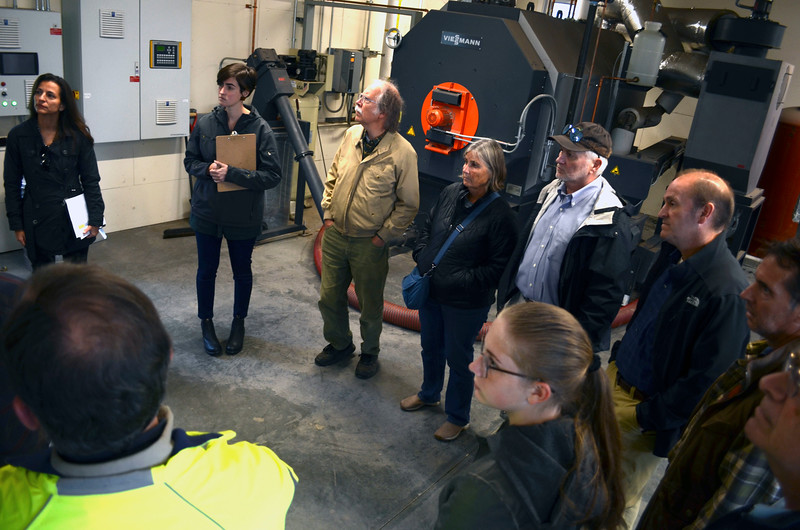 David LaChance — Bennington Banner<br /> Participants listen to a description of the wood-chip-fired heating system at Applegate Apartments in Bennington during a tour of biomass heating systems on Oct. 29 organized by the Bennington County Regional Commission.