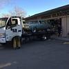 Flatbed truck unloading Biquette at Orinda Classic Car
