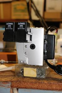 Headlight relays in their mounts