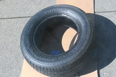 Rear tire showing lettering covered over