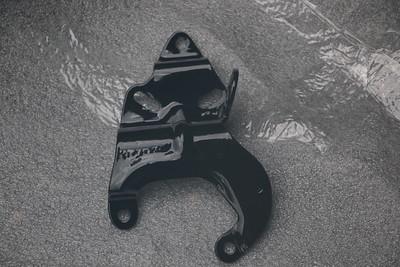 Power-coated Power steering pump bracket - front