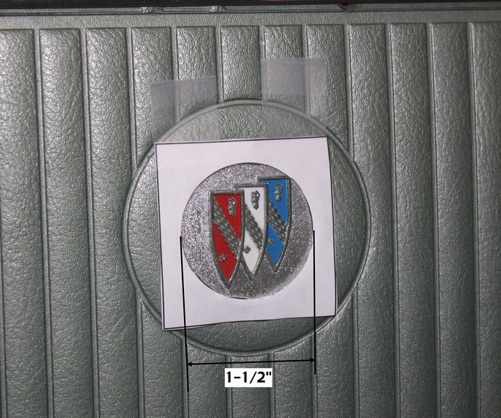 The door panel of a 1965 Buick Deluxe Special with it's molded Tri-Shield emblem.