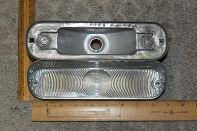 Parking light lens and old housing - top view