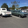Biquette parked next to a 1954 Chevy pickup truck
