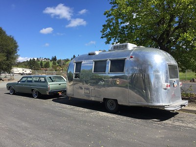 Biquette and a 1965 Airstream globetrotter - port rear