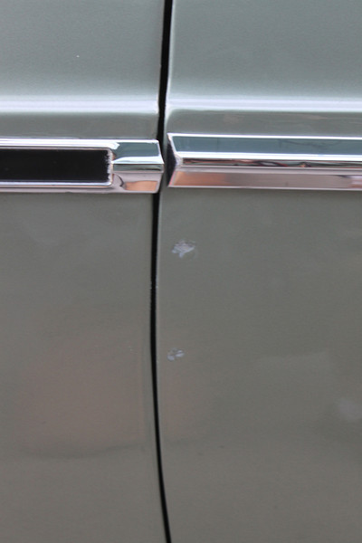 Close-up of clipped paint damage